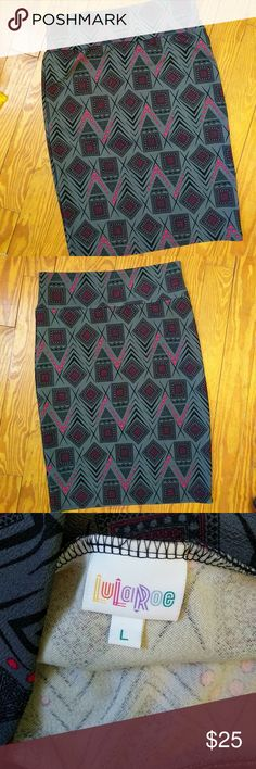 Lularoe Cassie Pencil Skirt Super cute hot pink, black, and gray print LLR Cassie! Only worn a handful of times, it was not my go to skirt!  Offers welcome! Bundle up!  This item is used and pictures show any wear. LuLaRoe Skirts Pencil