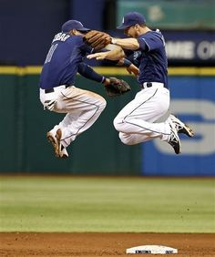 Tampa Bay Rays' Ben Zobrist, right, and Yunel Escobar celebrate at the end of a baseball game against the Minnesota Twins Thursday, July 11, 2013, in St. Petersburg, Fla. The Rays won 4-3. (AP Photo/Mike Carlson)