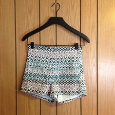 H&M Divided black pink mint high waist shorts H&M Divided high waisted denim shorts featuring a black, pink, and mint Aztec print. Women's size 8, new with tags. H&M Shorts Jean Shorts