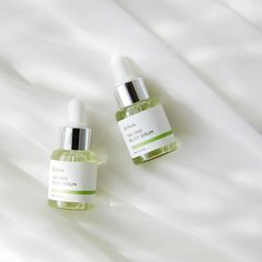 A serum infused with tea tree water and centella asiatica leaf water to heal skin for a clearer complexion. Serum, Phone Shop, Spot Treatment, Cosmetic Packaging, Cleansing Oil, Tea Tree Oil, Skin Care Regimen, Body Care, Perfume Bottles