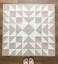 """I've been wanting to make a quilt in this HST pattern FOREVER, so when I heard that one of the (sweetest ever!) PA's at our allergy shot clinic is is having her 4th baby, this neutral option seemed like a perfect baby quilt for her. (It was supposed to be a bit bit bigger - 40"""" finished - but due to cutting my blocks the wrong size, it finished at 36"""". =) To top it off, I had to rip out the last 4 horizontal seams, but despite all that, it was a fast afternoon of sewing.  But it made me…"""
