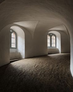 The Rundetaarn or Rundetårn is a tower located in central Copenhagen, Denmark. Ancient Architecture, Interior Architecture, Round Tower, Interior Rendering, Interior Design, Secluded Beach, Shades Of White, Elegant Homes, 17th Century