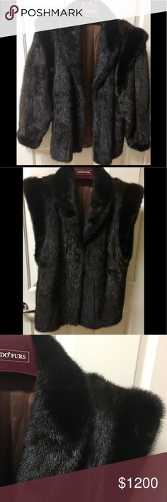 Boutique Black Mink Coat Detachable Sleeve Vest 14 Make a statement in this Mink Coat made in Finland. Purchased at a Boutique in Paris. Color is brown black. Amazingly soft. Sleeves are detachable by zipper to wear as a vest. A true staple for your wardrobe all year long. Label inside reads Finland and no size tag. I would say this Coat is a size 14. Please ask for measurements. Paid well over $3000 and never worn. Jackets & Coats