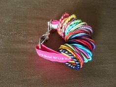 Use a Thirty-One key fob to keep all your hair ties in one place! No more lost hair ties!! :)