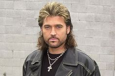 Singer Billy Ray Cyrus proudly showcases his highlighted blonde mullet hairstyle