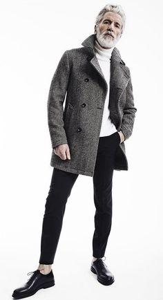 Aiden Shaw wearing Grey Herringbone Overcoat, White Turtleneck, Black Chinos, Black Leather Oxford Shoes