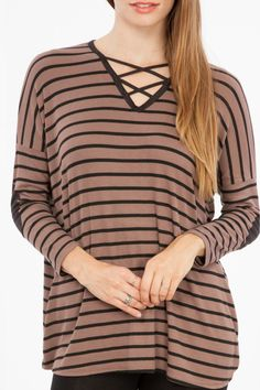 Striped long sleeve top with a crisscross neck and black elbow patches.   Crisscross Top by Peach Love California. Clothing - Tops - Casual Texas