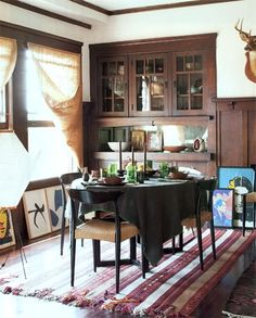 fabulous Craftsman built-ins ,striped rug, art (not the deer head or modern chairs)