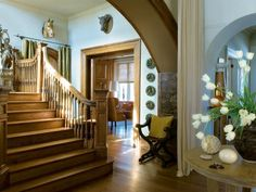 HGTV.com loves this country-style entryway with a gorgeous oak staircase and faux animal heads.