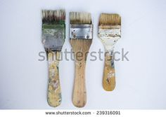 Used artist brushes prepared for painting on white canvas - stock photo