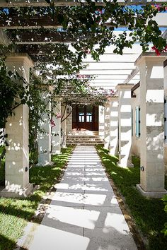 Covered with lush, curling bougainvillea, the pathway to the main villa entrance was inspired by true Barbadian plantation villa architecture and exemplifies the elegant luxury of the villa. Situated on the Island of Providenciales in the Turks and Caicos, is the villa Amazing Grace.