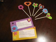 Matching goody bag cards (with a poem) and cupcake toppers.
