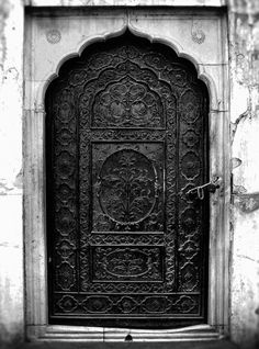 carved black door