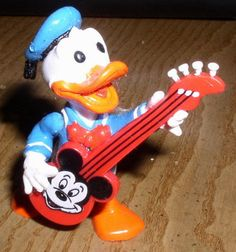 Donald Duck holding Mickey Mouse's Guitar Figure