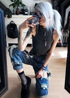 Choker tattoo with pendant necklaces, grey sleeveless top, distressed denim, fishnet socks & creeper shoes by kimiperi