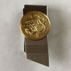 "Gold plated round sterling silver coin with GRAGON according to Chinese zodiac by year animal signs symbols on Stainlees steel money clip. Length of money clip 2 1/4"", width - 3/4"". Coin with symbol measured 1"" in diameter and hallmarked ""925"". Condition excellent new item."