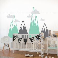 Mountain Vinyl Wall Decals are trending in babys nurseries and kids rooms. The triangular shape and pattern is very popular and is a recognizable shape for kids as they begin to develop and see shapes and patterns. Bring nature in with this mountain view set that also comes with a set of pillow-y clouds to add above them, or overlap them on the mountains as shown.  { APPROX. SIZES }  Mountains: 56 tall x 23 wide 42 tall x 23 wide 33 tall x 23 wide 28 tall x 23 wide  Clouds: 16 tall x 8 wide…