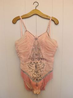 Vintage showgirl costume from the UK. The story from the seller is that it is from the 1950s. Size 10-12 (aus sizing)