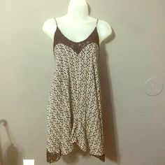 Tribal and Lace dress Tribal and lace dress with an asymmetrical cut and adjustable straps. Black and white. Good condition. Sweetheart and scoop neck lines. Size large. No trades ️️ or Ⓜ️ercari. Ask me about bundles  offers always considered when submitted via the offer button  Wet Seal Dresses Asymmetrical