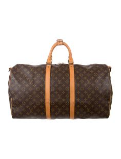 Brown and tan monogram coated canvas Louis Vuitton Keepall Bandoulière 55 with brass hardware, tan vachetta leather trim, dual rolled handles, optional shoulder strap, brown canvas lining and zip closure at top. Date code reads VI0920. Shop authentic designer handbags by Louis Vuitton at The RealReal.