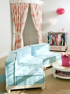 use a rounded shower curtain rod and 2 pretty shower curtains to make a stage for the playroom