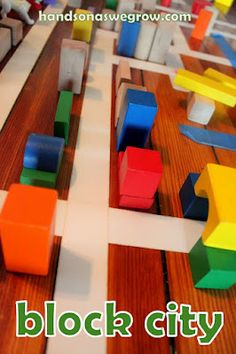 Building a city with blocks. Create your neighborhood of buildings - add cars, animals for pets, and put out fires!