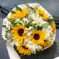 Just looking at sunflower bouquets for the bridesmaids. With you carrying pink flowers (right?) I thought we need sunflowers with a soft edge. Let me know what you think.