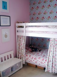 Ikea bunk bed, painted white, curtains added for