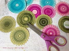 Making flowers using a spirograph.  I bought one a while back at a thrift store.  Love this idea!