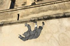Tintin, falling downa Roman wall in Arles, France. Unexpected and beautifully drawn. For the Word Press Weekly Photo Challenge: Surprise