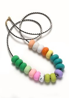 This necklace is part of the Memphis Terrazzo range and features eighteen hand-formed patterned, textured and coloured polymer clay threaded onto a...