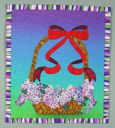 """Inspiration Basket"" mini quilt, 13.5 x 12"", by Jodi Scaltreto. Fused, machine appliqued and free motion quilted."