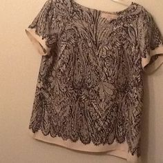 Dress top White and black 100% polyester flows top. Petite large Loft. Short sleeve w darted bust. Fits loosely LOFT Tops Blouses