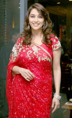 Madhuri can give jitters to the latest fashion divas! Saree being a favorite garment. Lets us look at Some Images Of Madhuri Dixit in Sarees. Bollywood Saree, Indian Bollywood, Bollywood Fashion, Red Saree, Beautiful Bollywood Actress, Most Beautiful Indian Actress, Indian Wedding Outfits, Indian Outfits, Bridal Outfits