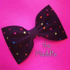 Black hearts rainbow fabric hair bow rockabilly pinup. $5.00, via Etsy.
