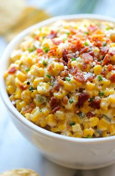 Slow Cooker Corn and Jalapeno Dip - Simply throw everything in the crockpot for the easiest, most creamiest dip ever!