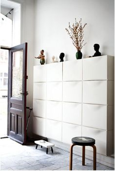 Storage can be more than functional. A wall of TRONES shoe cabinets looks modern and sculptural in this entryway from blogger Henriette Wleth.