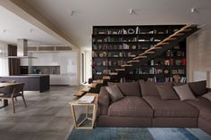Love the idea of a floor to ceiling bookcase near the staircase, very cleaver Tx