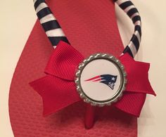 New England Patriots Flip Flops Red Flip Flops Navy and White ribbon Red bow Bottle cap with Logo  Available in Kids and Adult sizes. Check with me for size availability. Blankets, Stadium Seat Cushions, Scarves, Pillows, Headbands, and Bows also available. Other Teams/Themes also available.