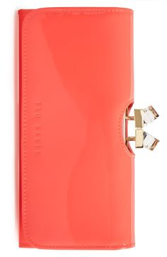 This coral Ted Baker wallet is so pretty, it might just have to be carried as a chic clutch, too.