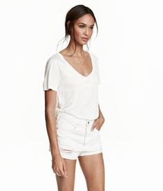 999 Short-sleeved V-neck top in softly draping airy jersey with a slight sheen. - Visit hm.com to see more.