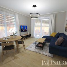 granatowa sofa, okrągły stół, dębowe meble Living Room