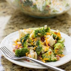 Broccoli Salad with Bacon and Cheese, aka Piggly Wiggly Salad, is a party and potluck favorite from the Midwest topped with sweet and creamy dressing.