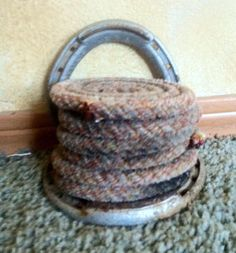 Six pink toned rope coasters with horseshoe holder. $25