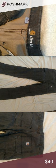 Unworn like new slim fit Carhartts for women! Dark grey color, no rups, stains, never worn. Slim fit so super feminine but are still touch Carhartts Carhartt Pants Straight Leg