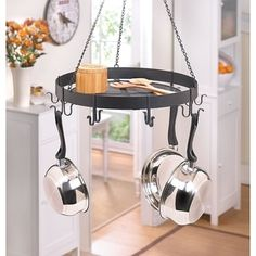 Pot Rack    A pot rack is always a smart idea when you become tired of rummaging through cabinets to fight the mess of lids, saucepans, and skillets. Hanging your cookware for all to see opens up cabinet space and gives your kitchen decor a cafe vibe.