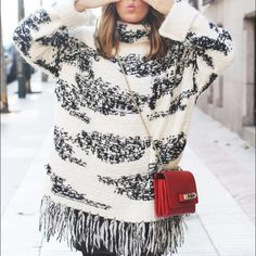 RARE NWT Zara black white fringe poncho sweater Size M (one size fits all). OUTER SHELL: 60% ACRYLIC, 15% POLYESTER, 10% WOOL, 10% MOHAIR, 5% NYLON. Price firm as I am still on the fence about selling this. Rare and sold out. Fits oversized. Zara Sweaters Cowl & Turtlenecks