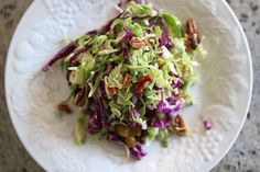 Brussel Sprout, Raisin, and Pecan Slaw with Maple Dijon dressing. Yum, yum city.