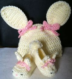 Cute bunny ears hat and snuggly bunny slippers for baby.