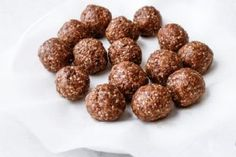 Curb a chocolate craving with a bite of these no-bake cacao bliss balls! Cacao Recipes, Raw Food Recipes, Dessert Recipes, Healthy Recipes, Healthy Foods, Diet Recipes, Snack Recipes, Raw Vegan Desserts, Healthy Desserts